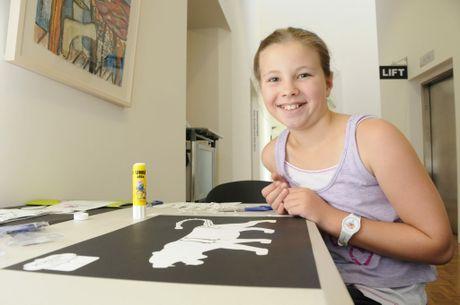 Chloe Biggar, 9, enjoying the Persian art project.