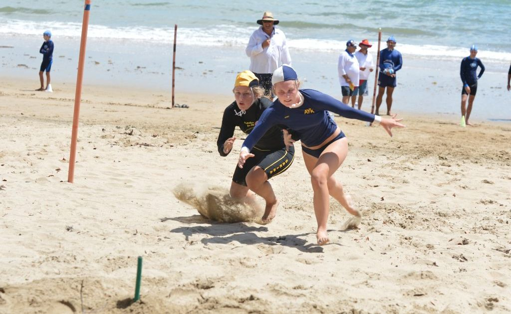 Sophie Street of Sarina and Joan Morgan of Ayr challenge each other during the u U17'S flag race at Eimeo Beach.