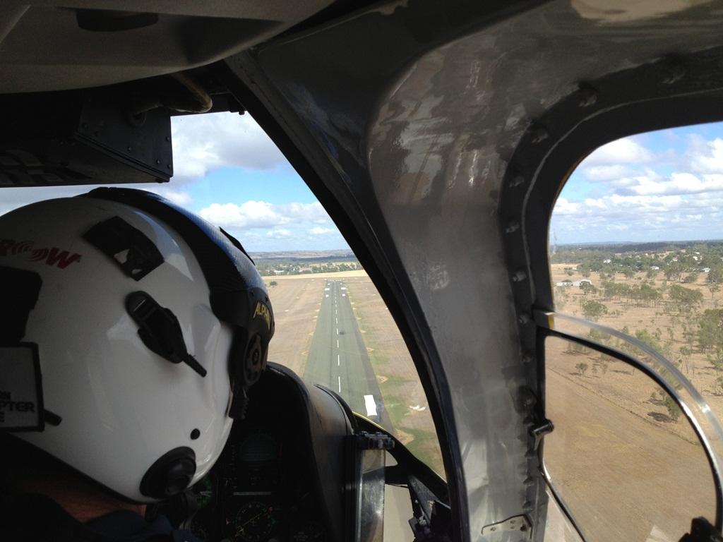 The RACQ Capricorn Helicopter Rescue team retrieves a car crash victim from Biloela for transport to Rockhampton.
