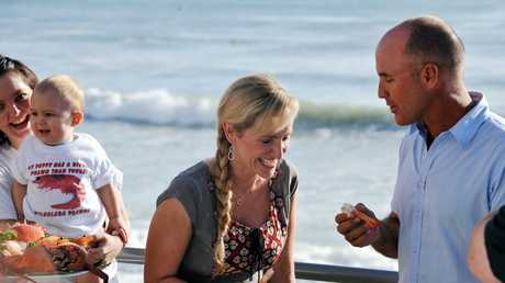 Sunrise weather presenter Fifi Box did a live cross from Mooloolaba. Fifi shares a prawn and a joke with former ironman Grant Kenny. Photo Warren Lynam / Sunshine Coast Daily