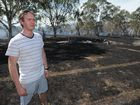 Roderick Smith on his burnt-out property in Shore Rd East. Fire came within metres of his home.