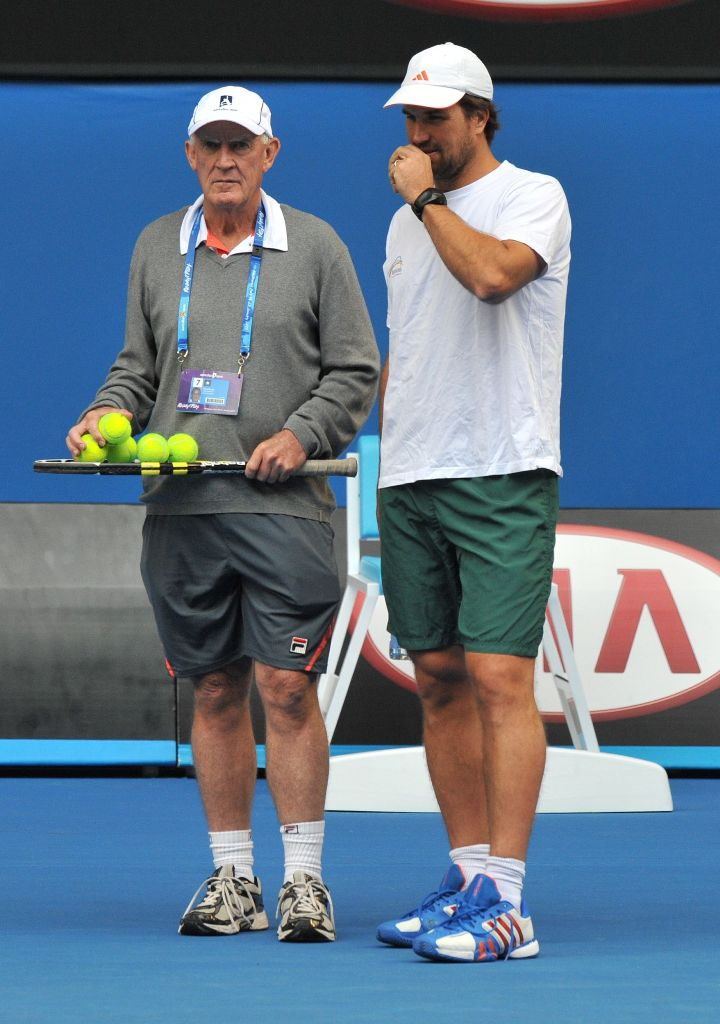 Tony Roach (L) and Pat Rafter speak during Australia's Lleyton Hewitt's training session ahead of the Australian Open tennis tournament in Melbourne on January 13, 2013.