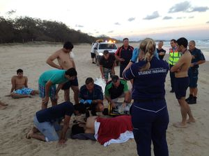 One taken to hospital as five people pulled from surf