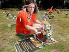 SHATTERED: Mary Beck at her daughter's grave at Warrill Park Lawn Cemetery. Mary is upset that the cemetery staff have placed letters on graves asking for all trinkets to be removed.