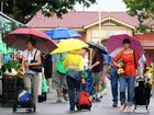 The first day of real rain has little effect Maryborough market goers, Umbrellas being the main accessory. Photo: Robyne Cuerel / Fraser Coast Chronicle