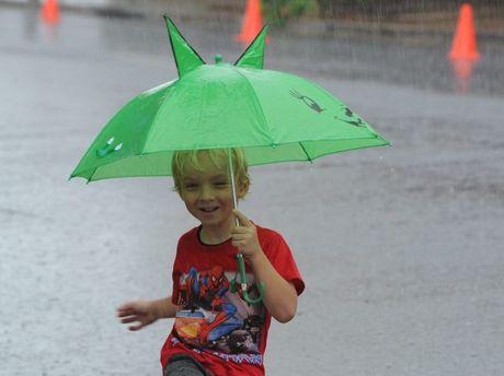 Maryborough Heritage Market Day. The simple timeless pleasure of playing in the rain captivates Cody Rosik Wright. Photo: Robyne Cuerel / Fraser Coast Chronicle