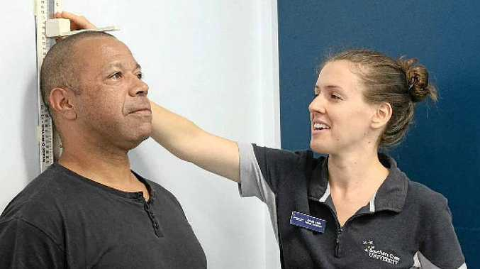 HEALTH KICK: Stephen Scott, one of Northern United Rugby League Football Club's trainers gets his medical exam at SCU's health clinic this week from student practitioner Jasmin Child.