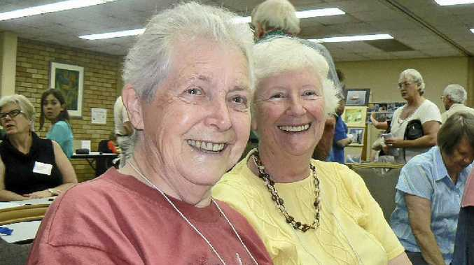 BRIGHT SPARKS: Shirley Beaver and Coralie Gardiner rally support at the U3A open day at the LismoreWorker's Club on Monday.