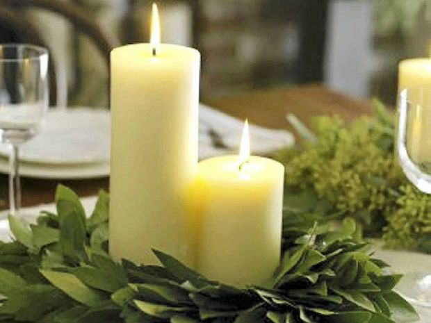 Candles and fresh greenery make a beautiful centrepiece. You can use almost any greenery from your garden as decoration for a table, especially when used with candles.