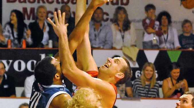 Greg Vanderjagt goes high for another basket for the Meteors.