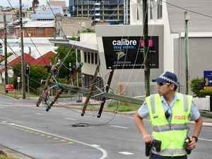 Crews work to restore power to CBD after 4WD knocks down pole
