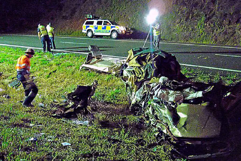 The scene at the Bruce Highway crash.