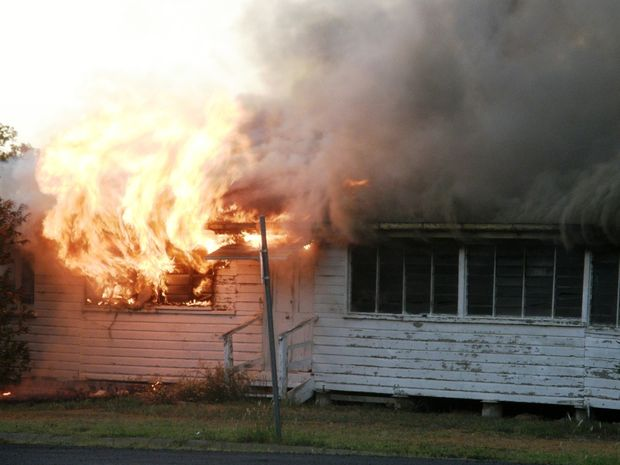 Police have charged an 18-year-old man with setting fire to this house on Ronald Street at Injune.