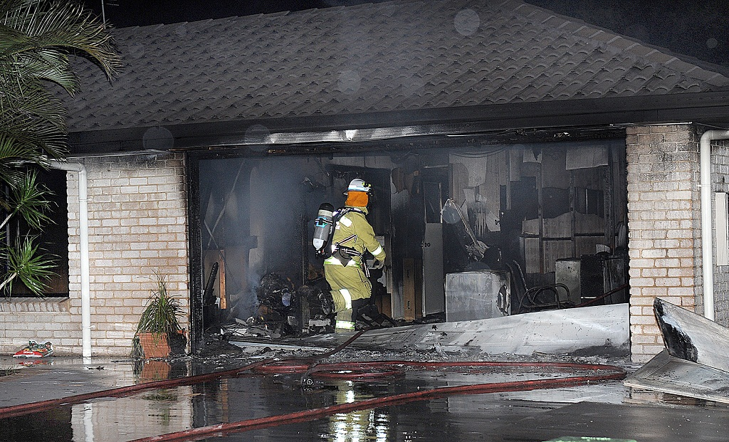 Firefighters managed to contain a fire to a Torquay home's double garage on Friday night.