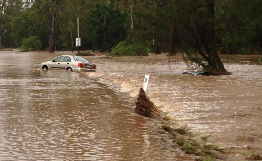 Two cars stranded on Gladstone Mt Larcom Rd, 200m from the turn-off.