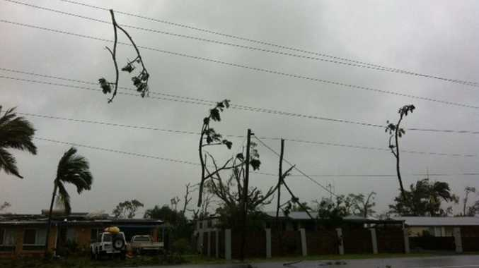 WILD WEATHER: Debris clings to powerlines in Bargara after a mini tornado tore through the area this afternoon.