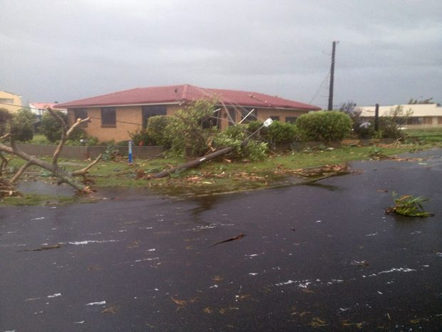SUDDEN DEVESTATION: Homes lose their roofs in Burnett Heads as the entire community is rocked by tornados that tear through the region indiscriminately. Photo: Max Fleet / NewsMail