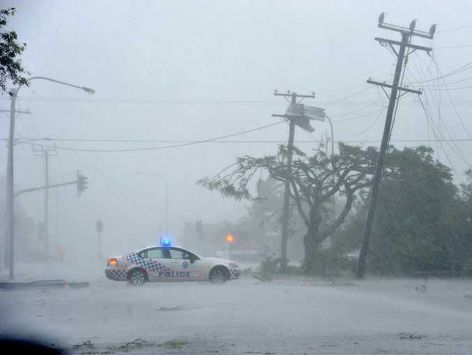 Bargara gets slammed by a vicious storm, uprooting trees, downing powerlines and ripping roofs off houses.