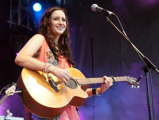 Kaylee Bell performs at Toyota Park in the grand final.