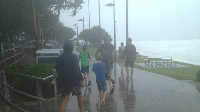 A family braves the weather at Mooloolaba