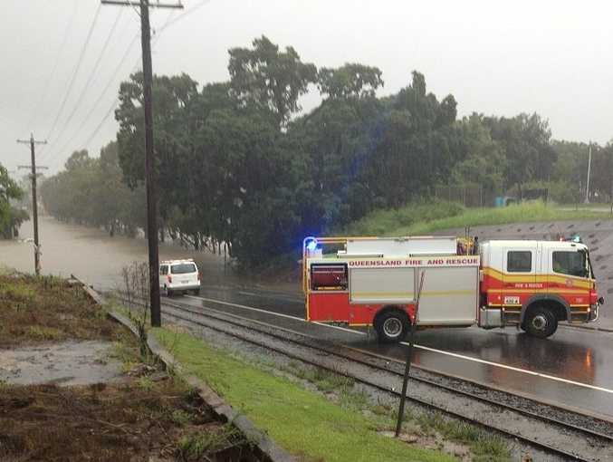 A car can be seen in the distance (middle left of photograph), submerged in floodwaters on Kent St in Maryborough.