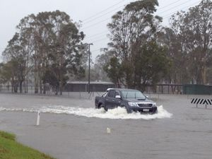 Motorists urged not to go into floodwaters, many roads cut