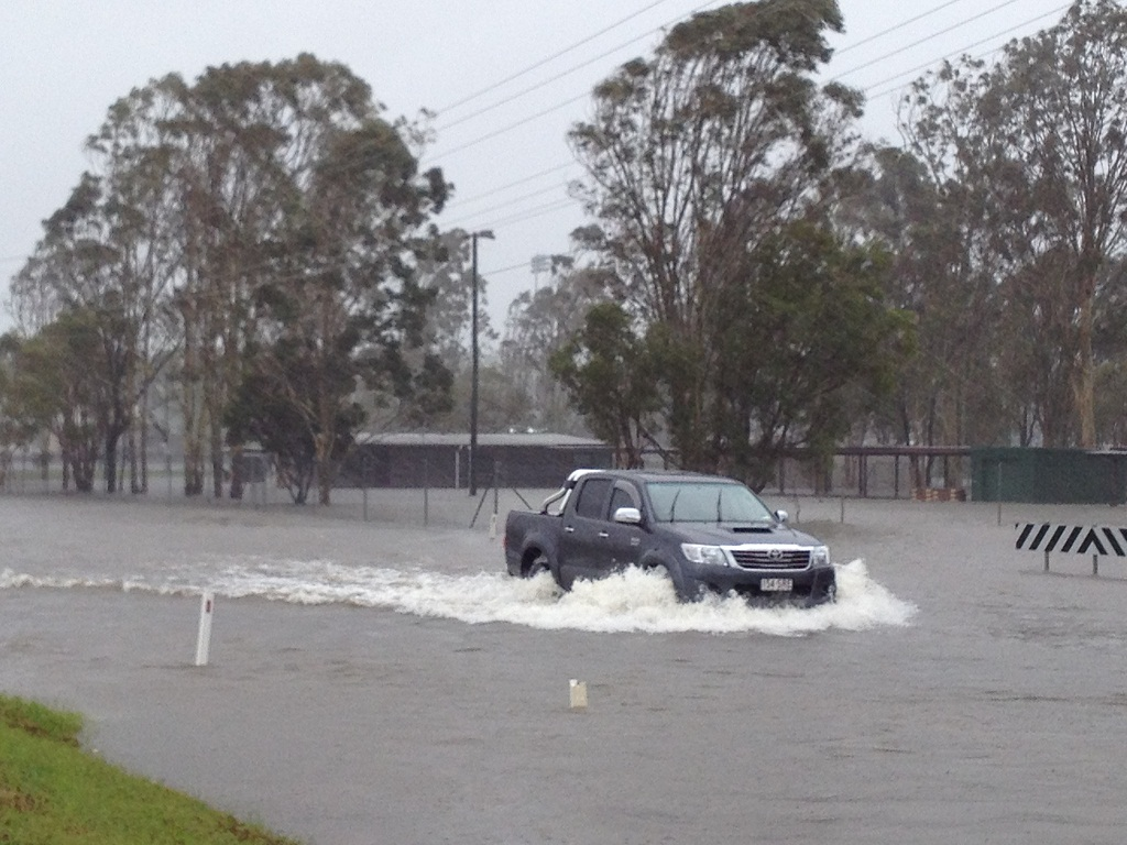 A ute passing through floodwaters on Boundary Rd, near the intersection with Tavistock St, at Torquay but police are urging drivers to stay off flooded roads.