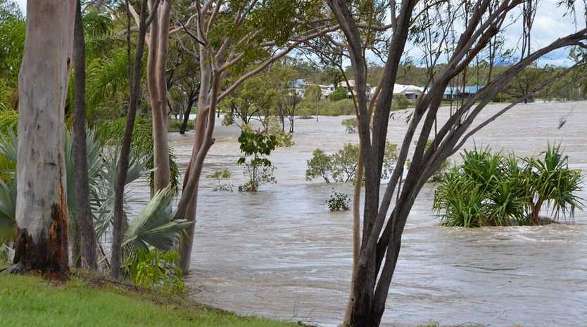 The back of Blackwell Street, Tannum Sands. The Boyne River has risen to the backyards of homes.