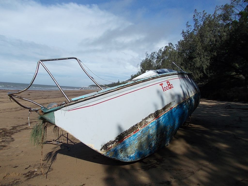 STORM DAMAGE: a boat washed up on the shore after the big storm in Hervey Bay.