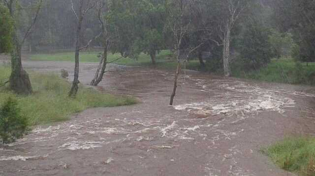 Howards Lane Creek breaks its banks at Alstonville this morning. Photo: Cara Feain-Ryan