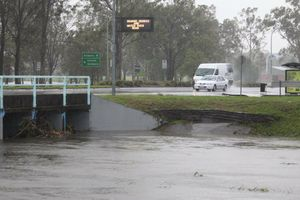Floodwaters rise at Beaudesert Rd near Coopers Plains in Brisbane.