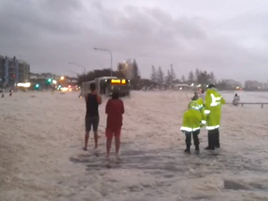 Car emerges from sea foam narrowly missing police