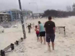 Sea foam covers Alexandra Headland
