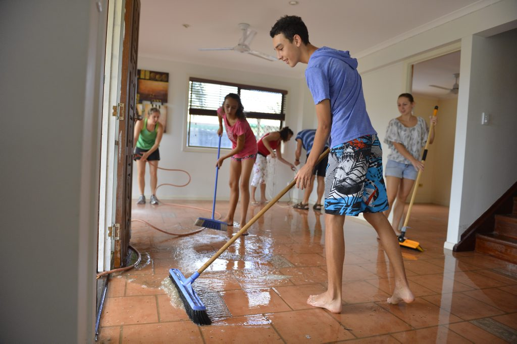 Liam Johnstone, 16 cleaning up after the floods.