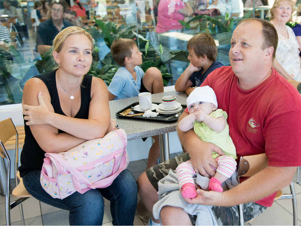 Sally Becker, Chris Hixon and daughter Summer wait for a flight out of Coffs. PHOTO: TREVOR VEALE