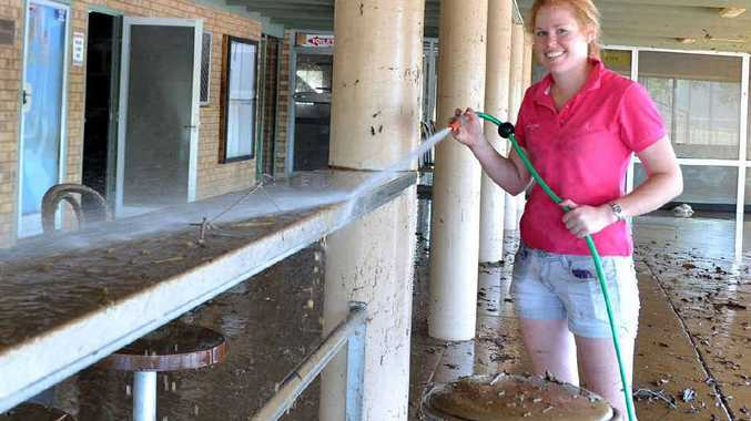 Sharon Jaenke lends a hand to clean up Football Gympie's facilities after flooding at One Mile Ovals.