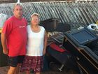 Hervey Bay couple Craig Davidson and Corleen Wood with items salvaged from their Urangan unit which was flooded with seawater.