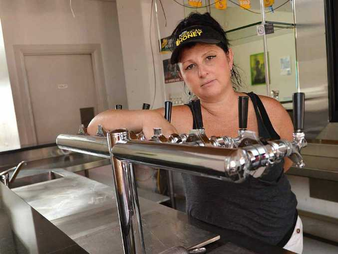Stacey Lowe was disgusted with looters who stole from The Royal Hotel during the floods.