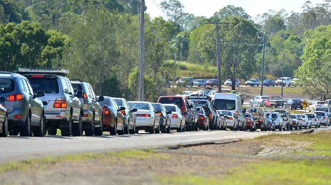 Vehicles backed up for kilometres yesterday morning as drivers headed across the only cross-river link, Normanby Bridge.