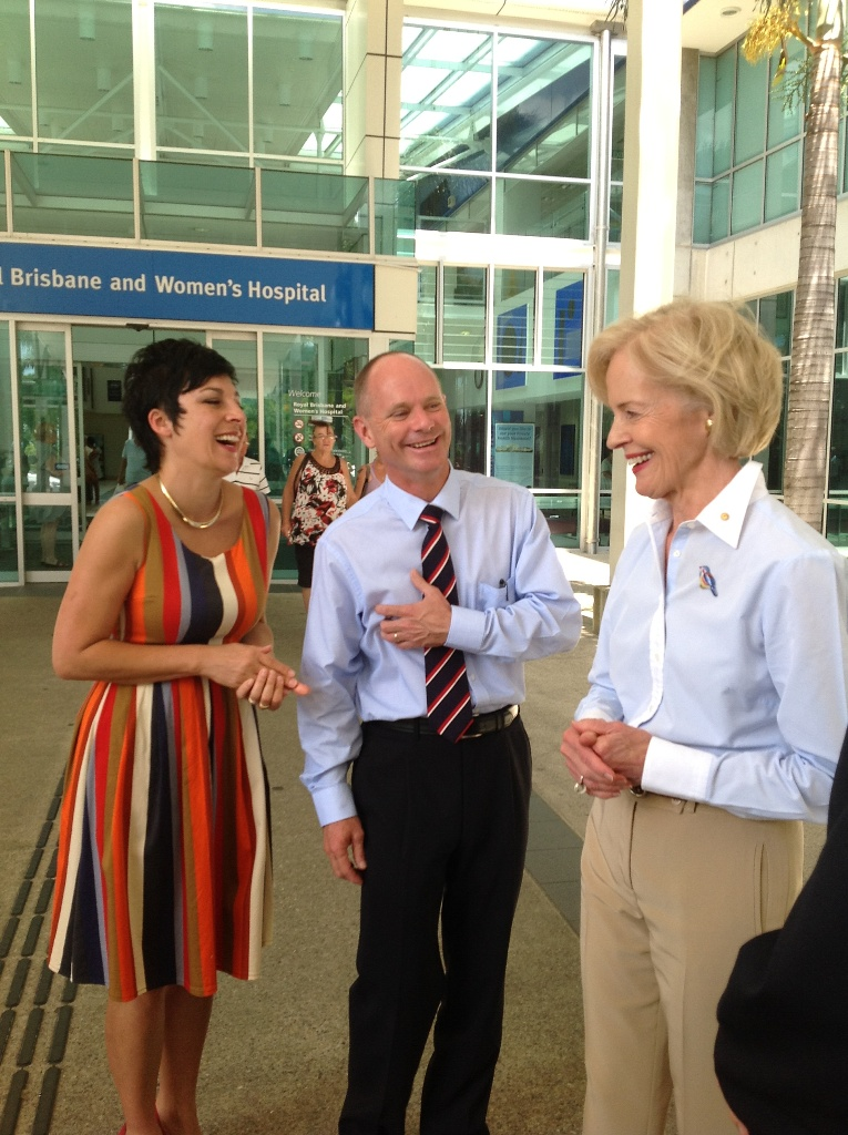 Premier Campbell Newman and wife Lisa (stripe dress) with Governor-General Quentin Bryce (blue shirt) after visiting patients airlifted from Bundaberg Hospital to Brisbane.