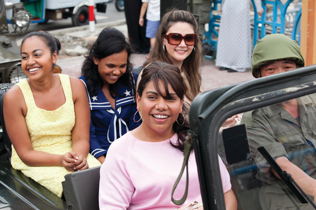 Deborah Mailman, front, with Jessica Mauboy (yellow), Miranda Tapsell, centre back, and Shari Sebbens in a scene fromThe Sapphires.
