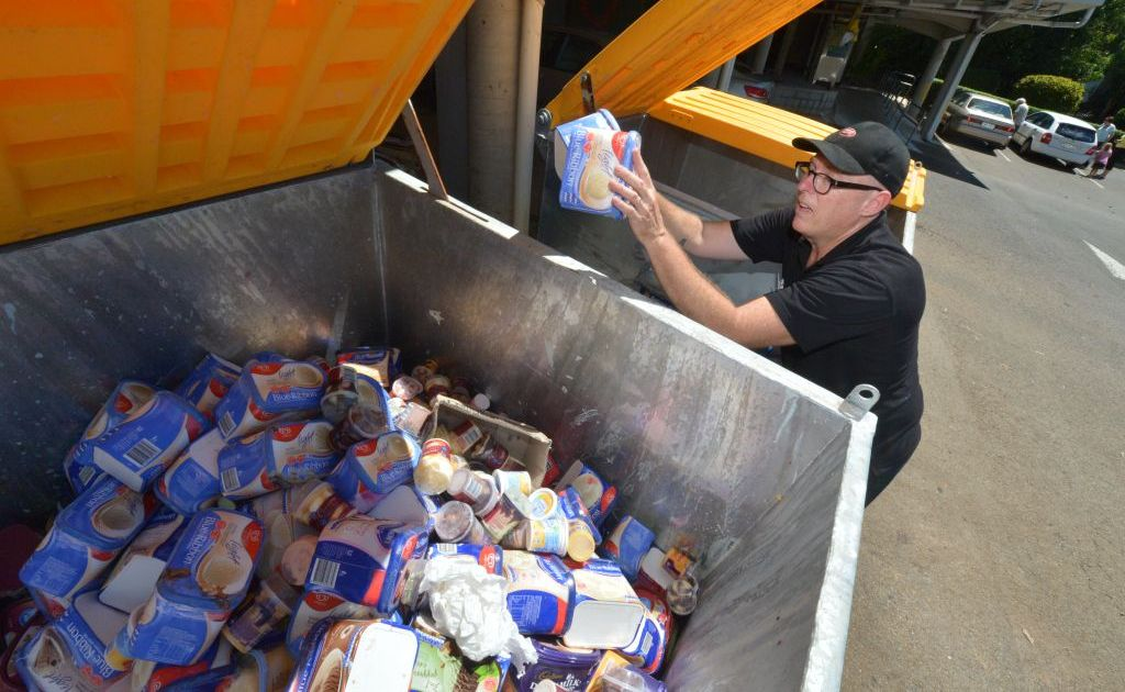 Owen Gray of the IGA throws out thousands of dollars worth of stock.
