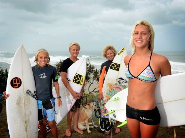 Young board riders Dane Pullinger, Dan Sinclair, Jai Ross, Cedar the dog and Jacinta Greenup in Cabarita Beach.