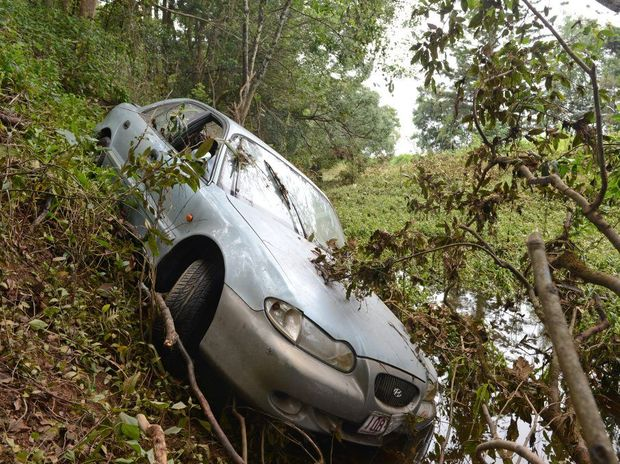 The car that was washed into the river.