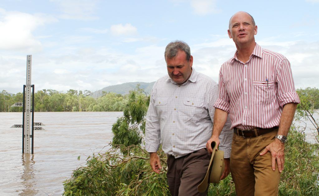 Police Minister Jack Dempsey and Premier Campbell Newman view the the Fitzroy River flood height during their visit yesterday.