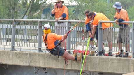 Southern Downs Council staff and the SES worked to remove a shipping container wedged under the McCahon Bridge yesterday.