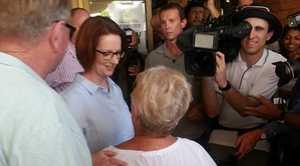 Prime Minister Julia Gillard comforts flood victims in Bundaberg.