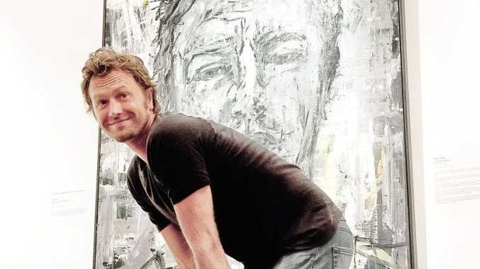 Vlad Kolas with his self portrait Other side of Midnight that won the 2012 Northern Rivers Portrait Prize.