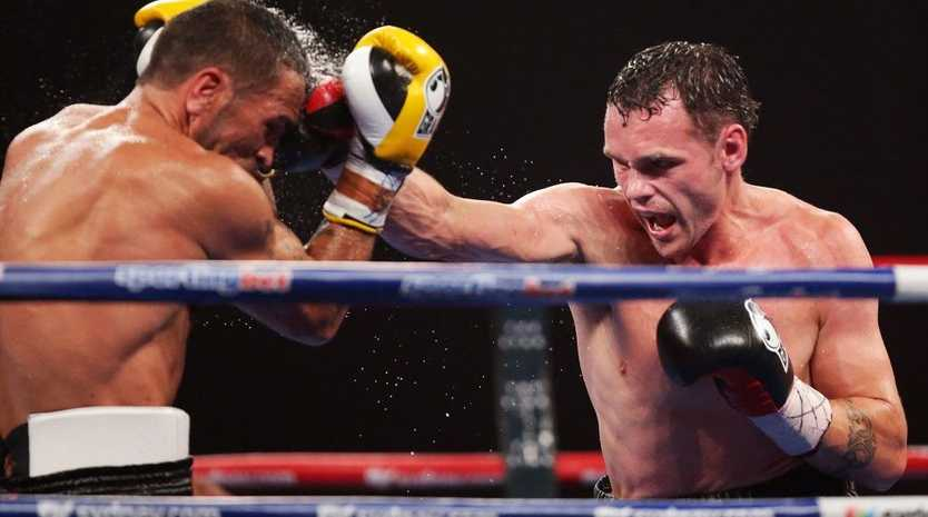 Daniel Geale (R) lands a right on Anthony Mundine (L) during the IBF Middleweight Title bout between Anthony Mundine and Daniel Geale at Sydney Entertainment Centre on January 30, 2013 in Sydney, Australia.