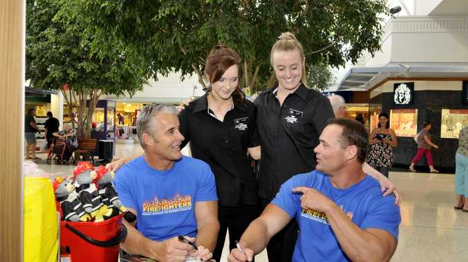 Getting up close to the Gold Coast firefighters are (back, from left) Fiona Binnie and Jess Harper, with (left) Bruce Mitchell and Dale Sorensen.